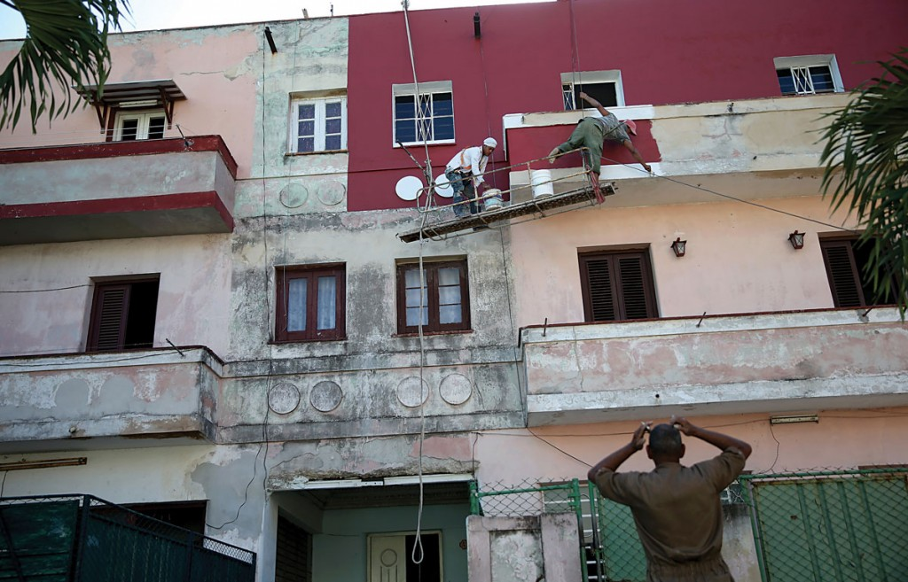 Workers paint the wall of a building in Havana, Cuba. U.S. and Cuban government officials are set to start a second round of talks on Friday to restore diplomatic relations between the two countries. (Joe Raedle/Getty Images)