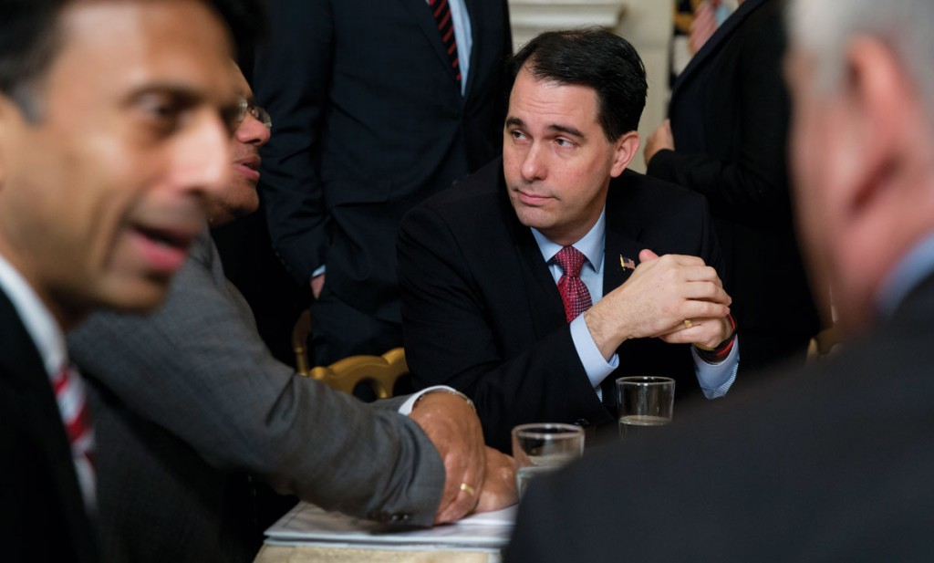 Wisconsin Gov. Scott Walker talks at his table before President Barack Obama arrives to speak to members of the National Governors Association, Monday, in the State Dining Room of White House in Washington.  (AP Photo/Carolyn Kaster)