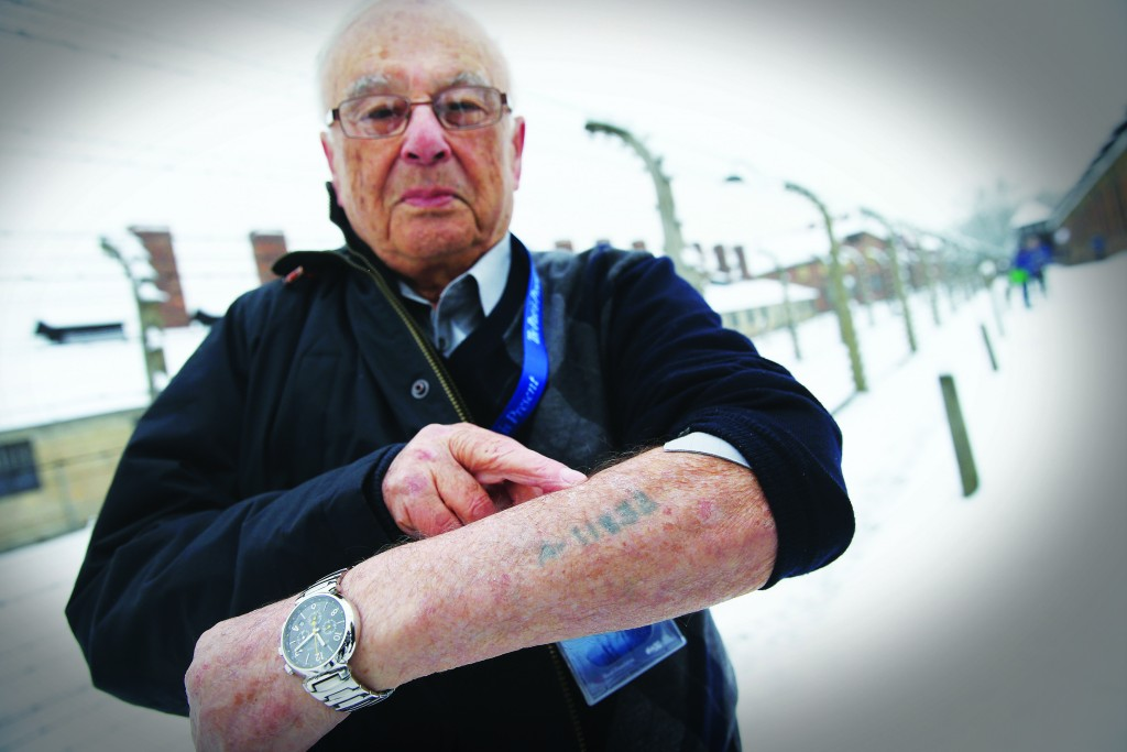 Jack Rosenthal, who was born in Romania and at 14 was imprisoned at Auschwitz and other concentration camps, stands outside the former Auschwitz concentration camp on January 26, 2015 in Oswiecim, Poland.