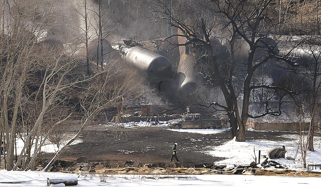 A crew member walks near the scene of a train derailment near Mount Carbon, WVa., Tuesday. (AP Photo/Chris Tilley)