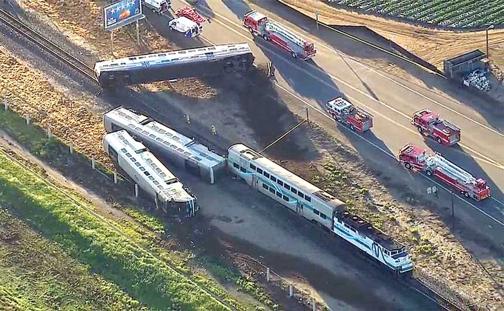 Wreckage of a Metrolink commuter train after it crashed into a truck and derailed early on Tuesday, Feb. 24, 2015, in Oxnard, California. (AP Photo/KABC)