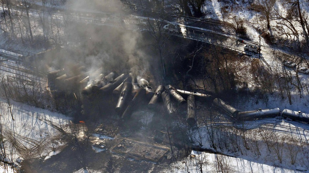 This aerial photo, made available by the Office of the Governor of West Virginia, shows a derailed train in Mount Carbon, West Virginia, on Feb. 17, 2015. As investigators in West Virginia and Ontario pick through the wreckage of the latest pair of oil-train derailments to result in massive fires, U.S. transportation officials predict that without new regulations, there will be many more catastrophic wrecks involving flammable fuels in coming years. (AP Photo/Office of the Governor of West Virginia, Steven Wayne Rotsch, File)