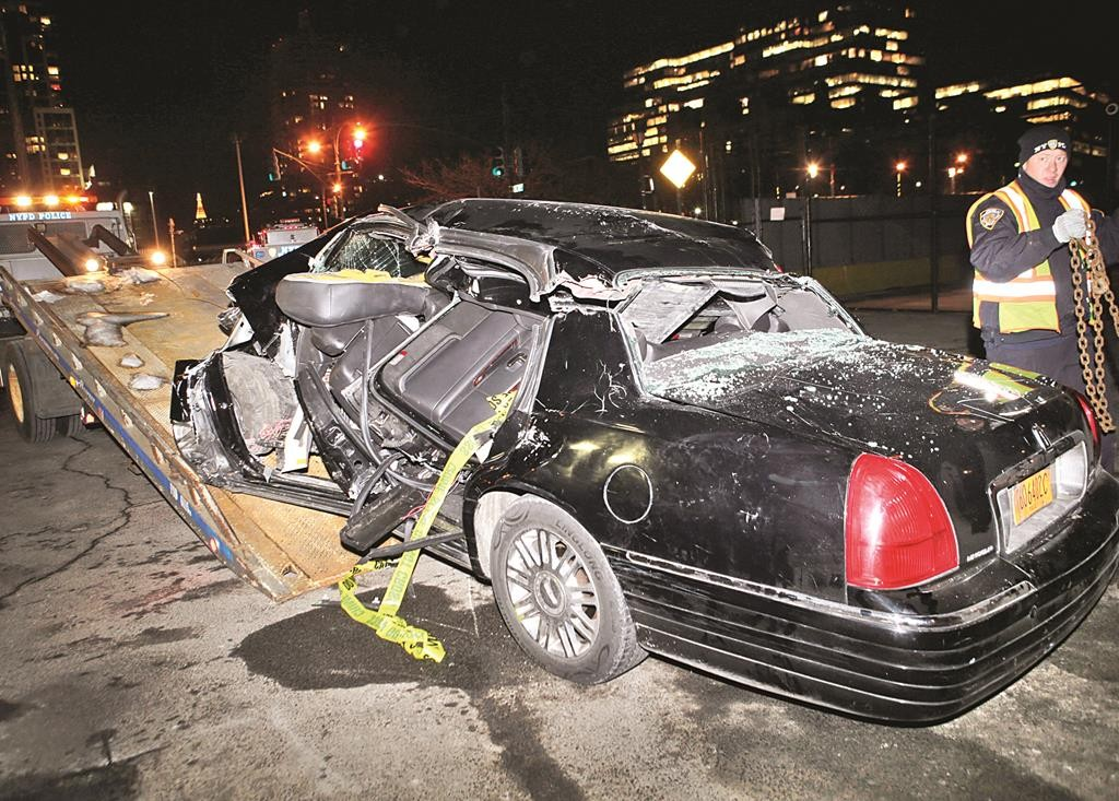 A Police Officer Last Wednesday Tows The Car That Was Driving Cbs Correspondent Bob Simon Following