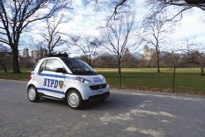 The NYPD's fleet of scooters (L) will be replaced by Smart cars (R).