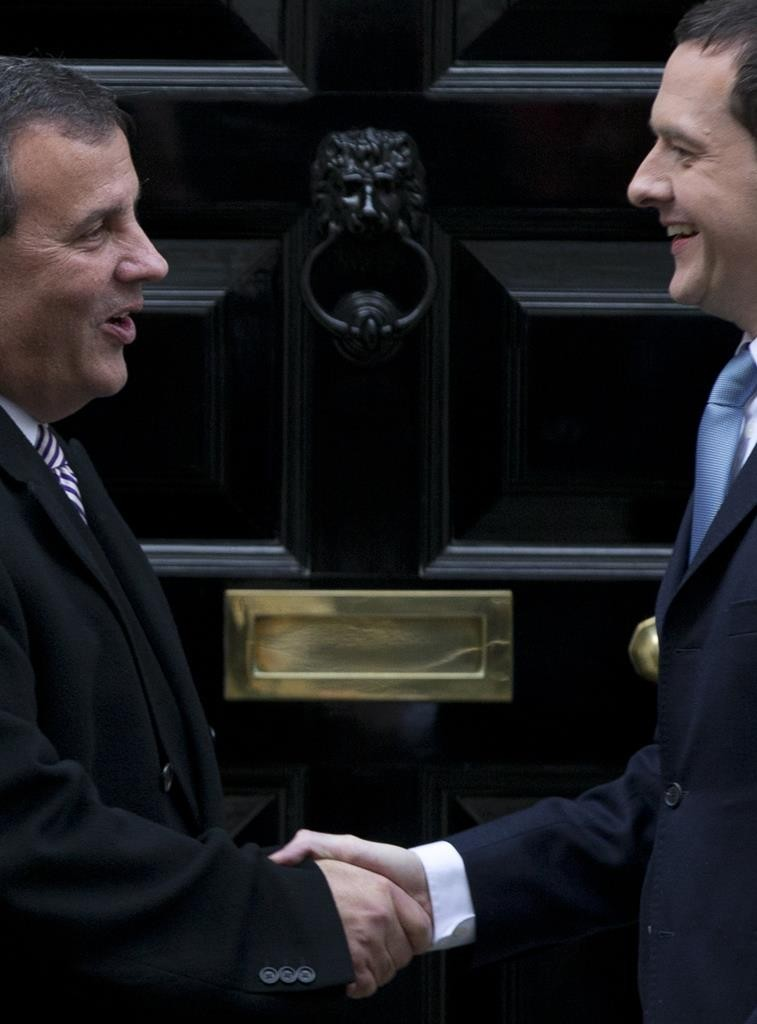 New Jersey Gov. Chris Christie (L) on Tuesday says goodbye to Britain's Chancellor of the Exchequer George Osborne, on the doorstep of 11 Downing Street. (AP Photo/Alastair Grant)