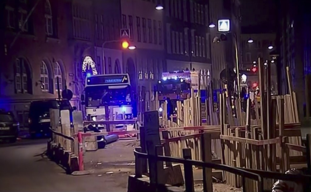The scene near a shul where police reported a shooting in downtown Copenhagen, Denmark, early Sunday. One man was killed and two police officers were shot in the arms and legs, police said. (AP Photo/TV2 via APTN)