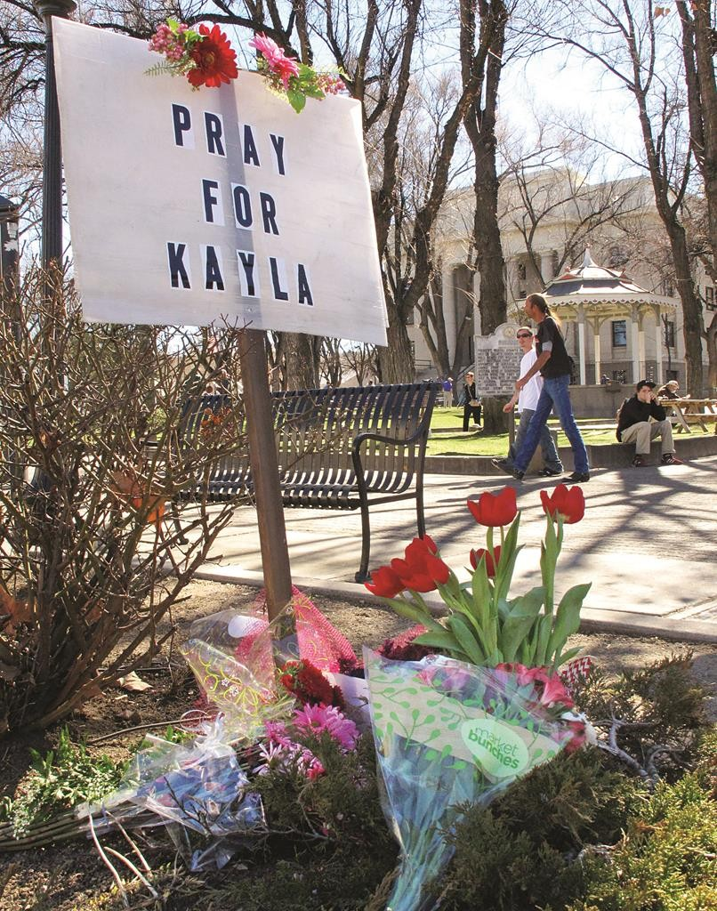 A small memorial honoring American hostage Kayla Mueller is on display at a corner of courthouse plaza in Prescott, Ariz., Tuesday. (AP Photo/Felicia Fonseca)