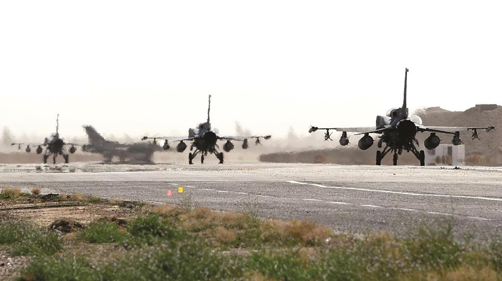This photo, released by WAM, the state news agency of the United Arab Emirates, shows Emirati F-16s at an air base in Jordan, Tuesday. The United Arab Emirates launched airstrikes Tuesday targeting the Islamic State terrorist group, its official news agency said. (AP Photo/WAM)