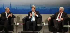 U.S. Secretary of State John Kerry (C) speaks, as French Foreign Minister Laurent Fabius (L) and German Foreign Minister Frank-Walter Steinmeier listen on the last day of the 51. Security Conference in Munich, Germany, Sunday. (AP Photo/Matthias Schrader)