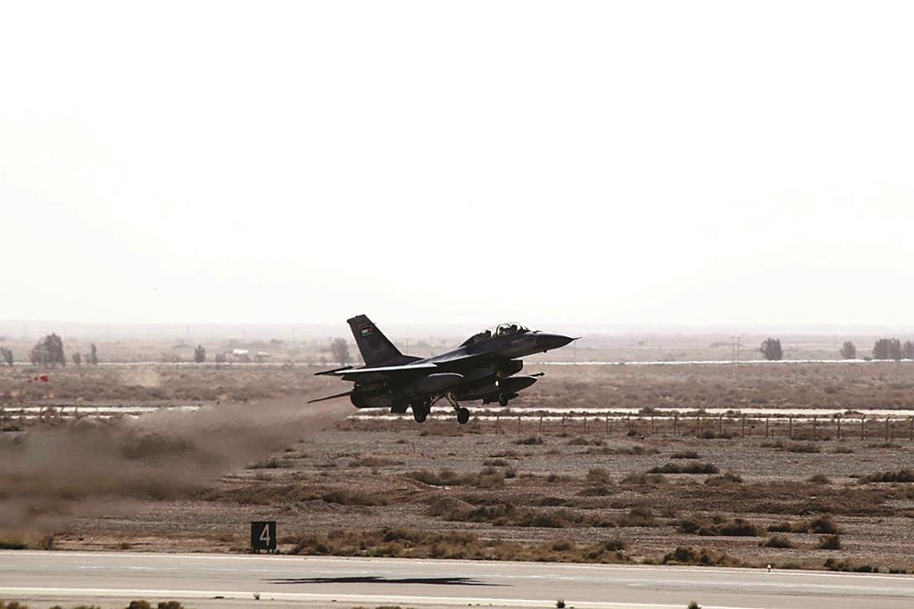 A Royal Jordanian Air Force jet takes off from an air base on its way to attack Islamic State in Raqqa, Syria, Thursday. (REUTERS/Petra News Agency)