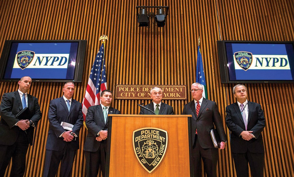 New York City Police Commissioner William Bill Bratton (C) answers questions with Diego Rodriguez (3rd L), assistant director in charge of the New York division for the FBI, and other FBI officials at One Police Plaza in New York Wednesday. (REUTERS/Lucas Jackson)