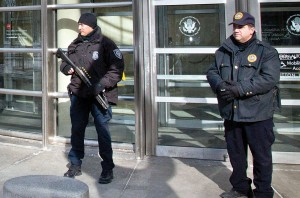 A Homeland Security police officer, left, joins a Federal Court policeman, right, as security is enhanced during the arraignment of two men on terrorism related charges, Wednesday, in Brooklyn, N.Y. (AP Photo/Bebeto Matthews)