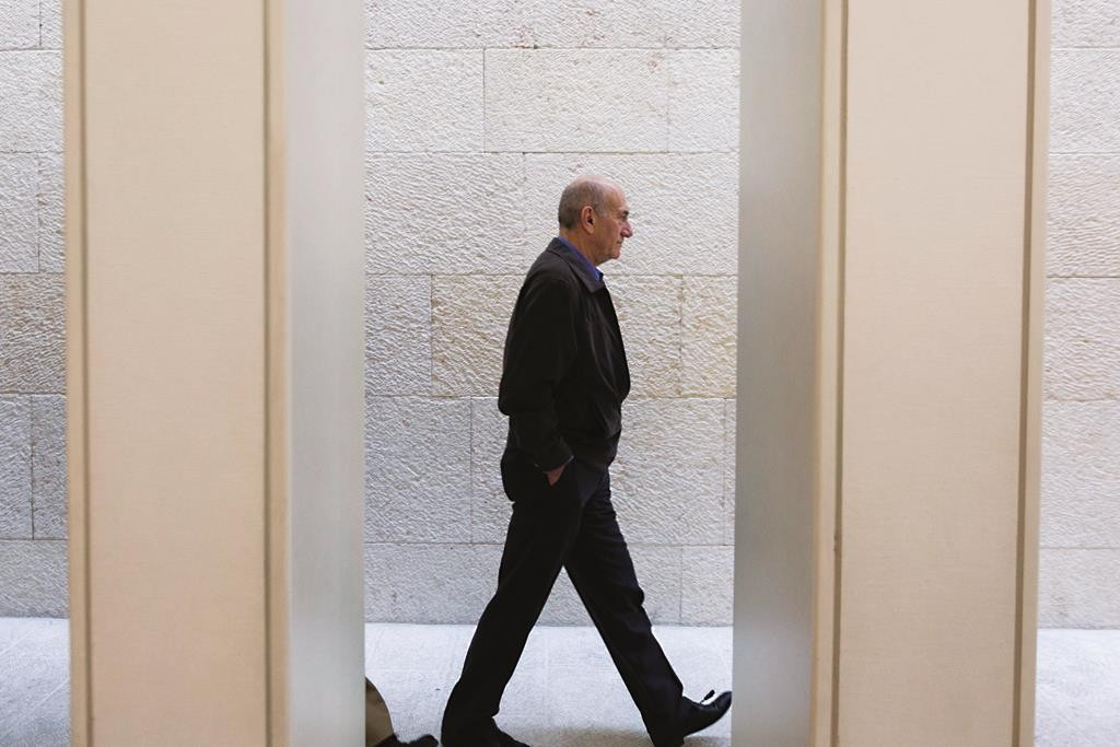 A glimpse of former Israeli prime minister Ehud Olmert in Yerushalayim recently. (David Vaaknin/POOL)