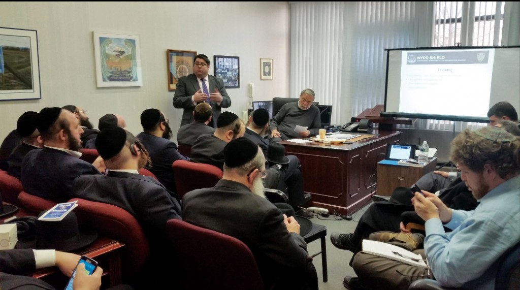 Sgt. Stephen Iannone of the NYPD Counterterrorism Division addresses representatives of local mosdos at the office of Assemblyman Dov Hikind, Sunday. (Office of Assemblyman Hikind)