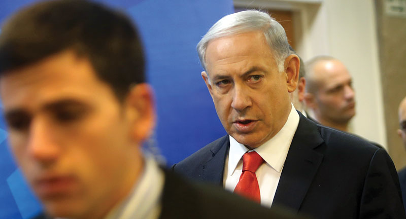 Israeli Prime Minister Binyamin Netanyahu arrives for the weekly cabinet meeting on Sunday. (Alex Kolomoisky/POOL)