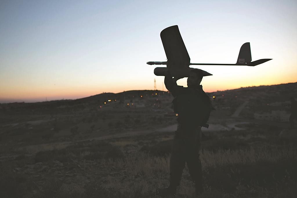 An Israeli soldier holds a drone, preparatory to launching. (Yonatan Sindel/Flash90)