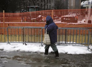 A pedestrian on Monday splashes through a slushy puddle in New York.