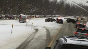 A Monsey Trails bus slid in the snow, partially falling into a ditch on the GSP on Monday.