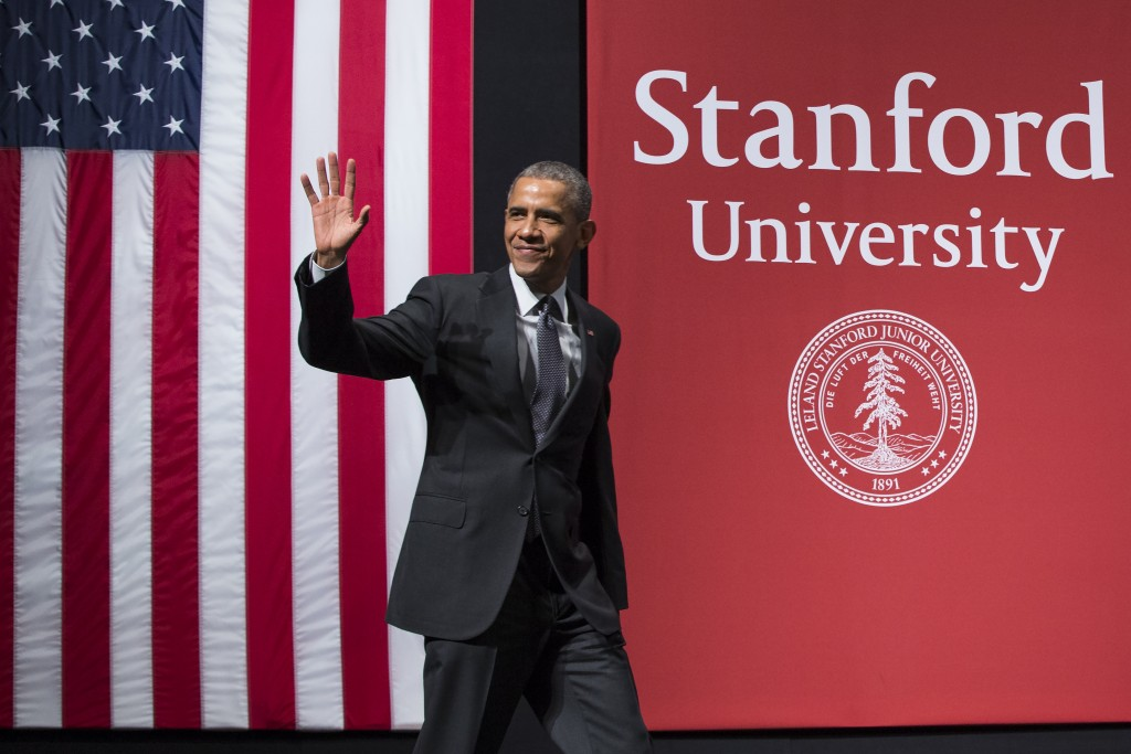 President Barack Obama waves as he arrives to deliver remarks during a summit on cybersecurity and consumer protection at Stanford University on Friday, Feb. 13, 2015 in Palo Alto, Calif. (AP Photo/Evan Vucci)