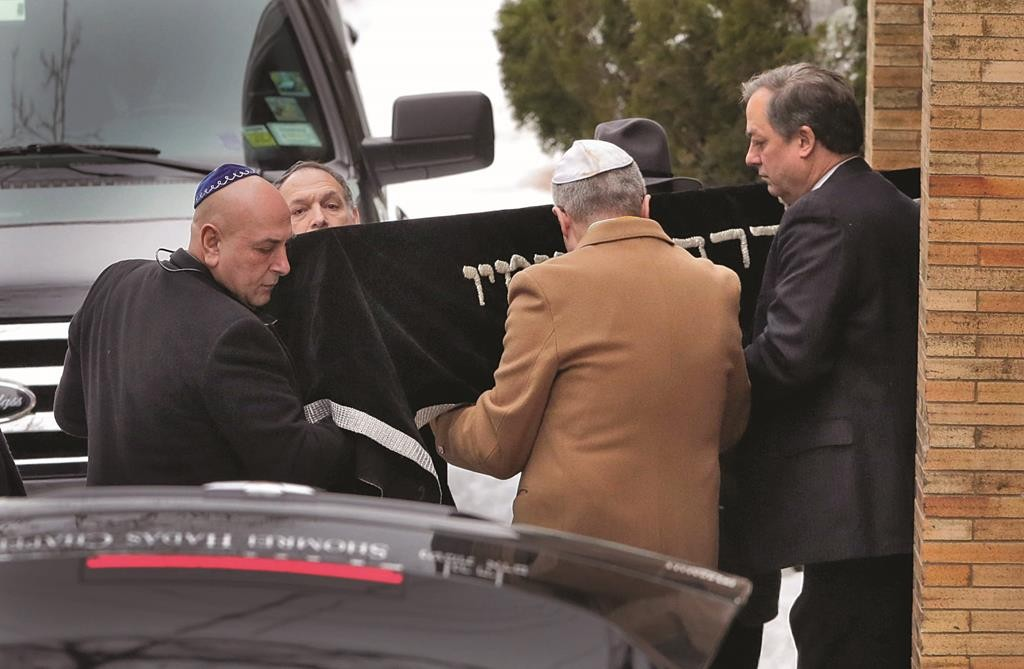 """The casket of Ellen Brody, a""""h, on Friday is taken out of the Chabad house after her funeral. (AP Photo/Mark Lennihan)"""