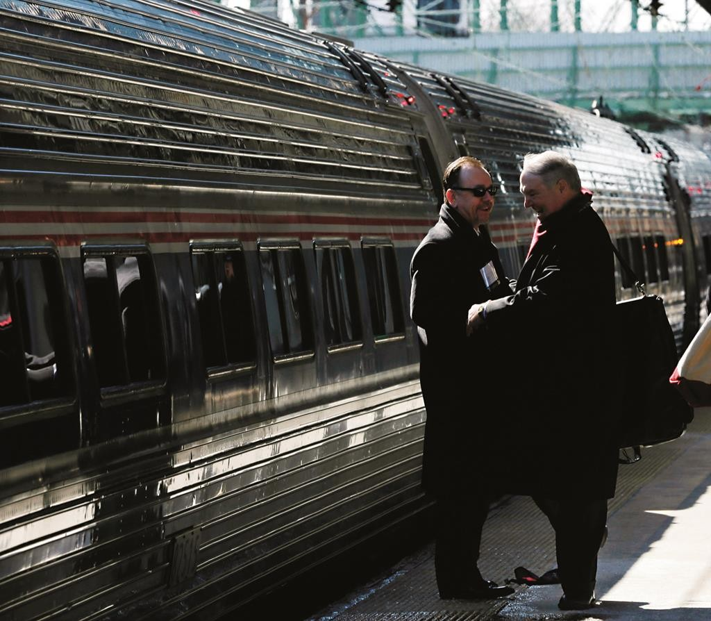 """People greet one another Thursday as they prepare to board an Amtrak train bound for Washington, D.C., for the annual """"Walk to Washington,"""" in Trenton. (AP Photo/Mel Evans)"""