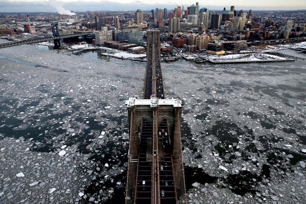 With Brooklyn in the background, ice surrounds the Brooklyn Bridge on Tuesday. February draws to a close as the third-coldest February on record in New York City, the coldest being 1934. The weather is expected to warn up to the 40s in time for Purim on Wednesday night. (AP Photo/Seth Wenig)