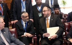Rabbi Chaim Dovid Zwiebel (L) and State Senator Simcha Felder. (Moishe Gershbaum)