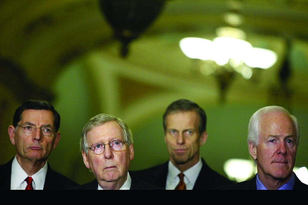 U.S. Senate Majority Leader Mitch McConnell (R-KY) (2nd L) listens to a question from a reporter with Senator John Barrasso (R-WY) (L), Senator John Thune (R-SD) (2nd R) and Senator John Cornyn (R) after the weekly Senate party caucus luncheons at the U.S. Capitol in Washington Wednesday. (REUTERS/Jonathan Ernst)