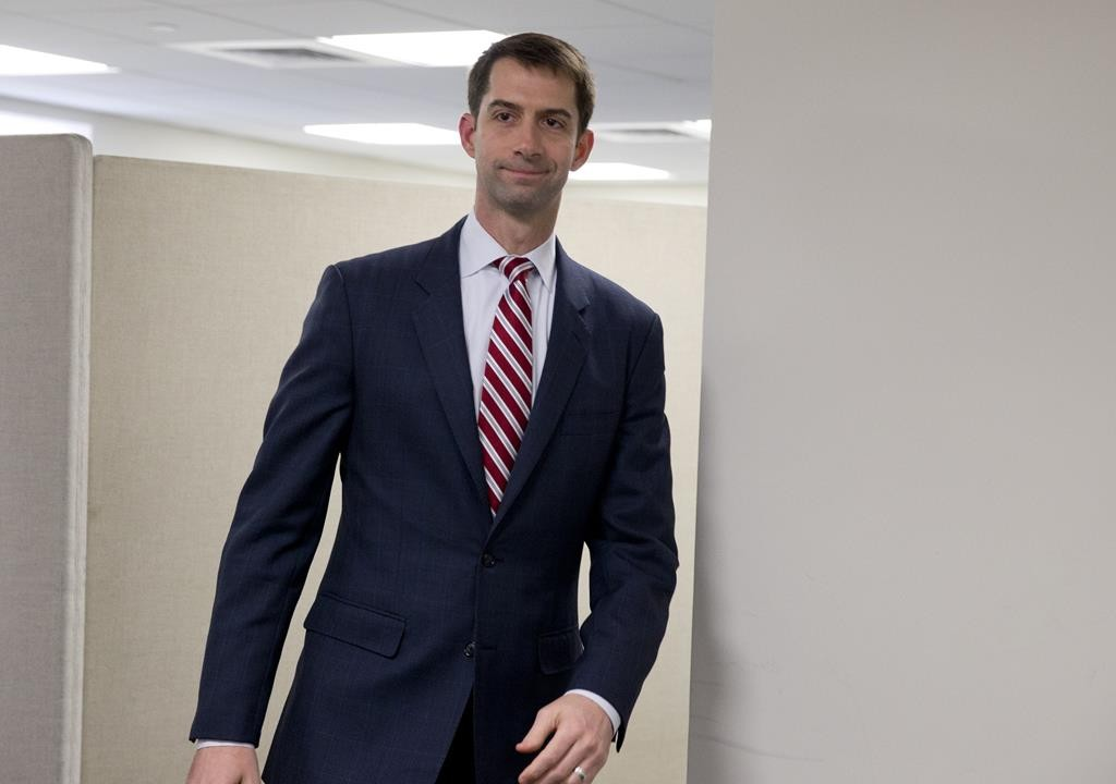 Sen. Tom Cotton (R-Ark.) arrives to pose for photographers in his office on Capitol Hill in Washington. (AP Photo/Carolyn Kaster)
