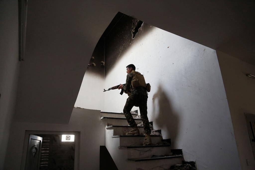 An Iraqi soldier searches a building for fighters of Islamic State in Tikrit.  (AP Photo/Khalid Mohammed)