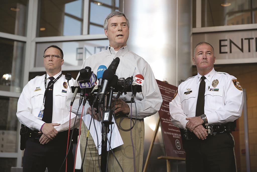 St. Louis County Prosecutor Robert McCulloch (C) speaks during a news conference alongside St. Louis County Police Chief Jon Belmar (R) and Webster Groves Police Captain Stephen Spear (L), Sunday, March 15, 2015, in Clayton, Mo. (AP Photo/Jeff Roberson)
