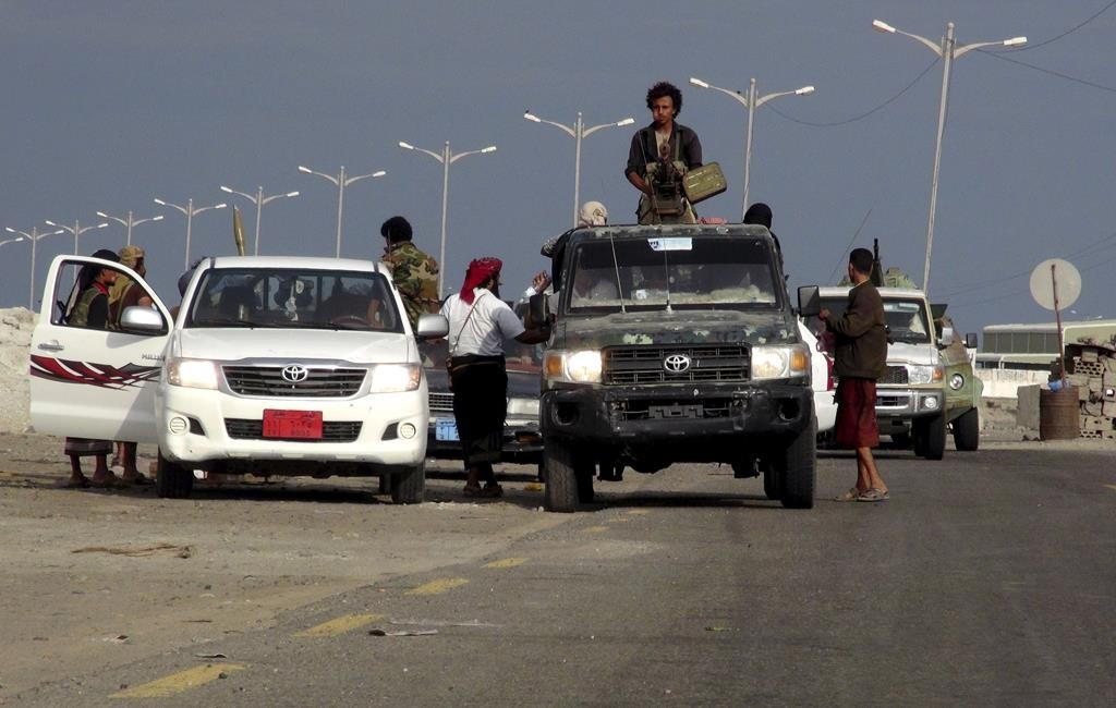 Fighters loyal to Yemen's President Abd-Rabbu Mansour Hadi patrol in Yemen's southern port city of Aden, Monday. (REUTERS/Nabeel Quaiti)