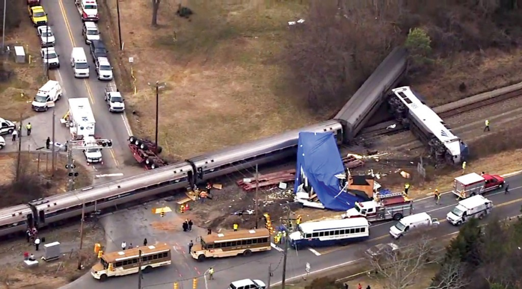 Authorities respond to a collision between an Amtrak passenger train and a truck, Monday, in Halifax County, N.C. Transportation officials say 40 passengers were injured when an Amtrak train collided with a tractor-trailer that was stuck on the tracks in North Carolina. An eyewitness says the tractor-trailer driver was trying to make a difficult right-hand turn. She says the driver jumped out of the truck before the crash. (AP Photo/WTVD-11)