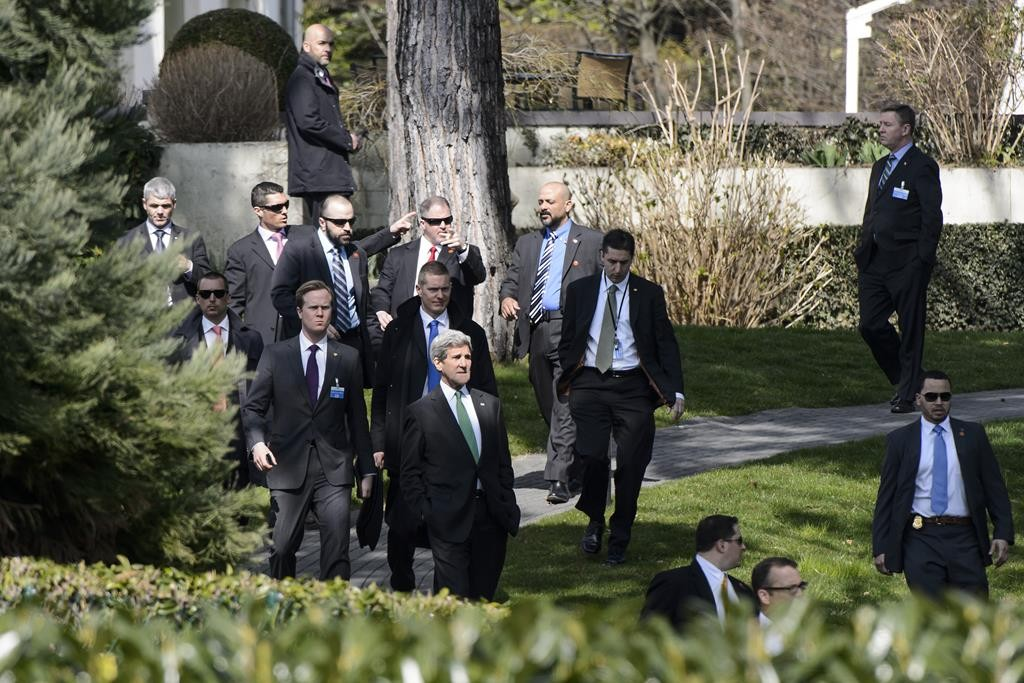 John Kerry, U.S. Secretary of State (C), walks outside the hotel during a break after a bilateral meeting with Iranian Foreign Minister Mohammad Javad Zarif, for a new round of nuclear talks, in Lausanne, Switzerland, Tuesday. (AP Photo/Keystone, Jean-Christophe Bott)