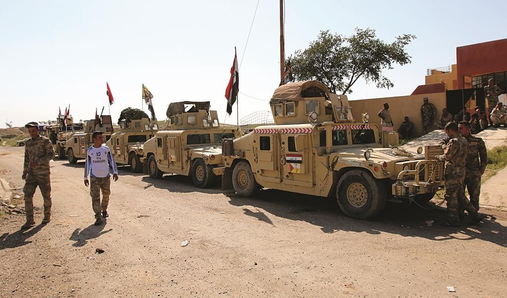 Military vehicles of Iraqi security forces and Shi'ite fighters are seen as they gather at Udhaim dam, north of Baghdad on March 1. Iraqi soldiers and pro-government Shi'ite militias have been massing in preparation for an attack on Islamic State strongholds along the Tigris River to the north and south of Tikrit, hometown of executed former president Saddam Hussein. (REUTERS/Thaier Al-Sudani)
