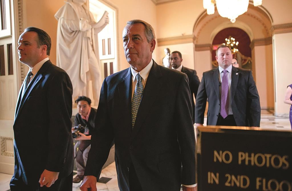 Speaker of the House John Boehner (R-Ohio) walks to the chamber as the House failed to advance a short-term funding measure to keep the Department of Homeland Security funded past a midnight deadline, at the Capitol in Washington, Friday. Conservatives in Speaker Boehner's own party fought against three-week funding measure because it would not overturn Obama's actions on immigration. (AP Photo/J. Scott Applewhite)