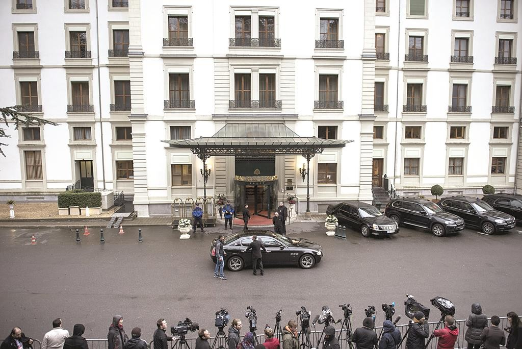 Members of the press await the arrival of delegates for a meeting at the Beau Rivage Palace Hotelin Lausanne, Switzerland, Sunday. (AP Photo/Brendan Smialowski, Pool)