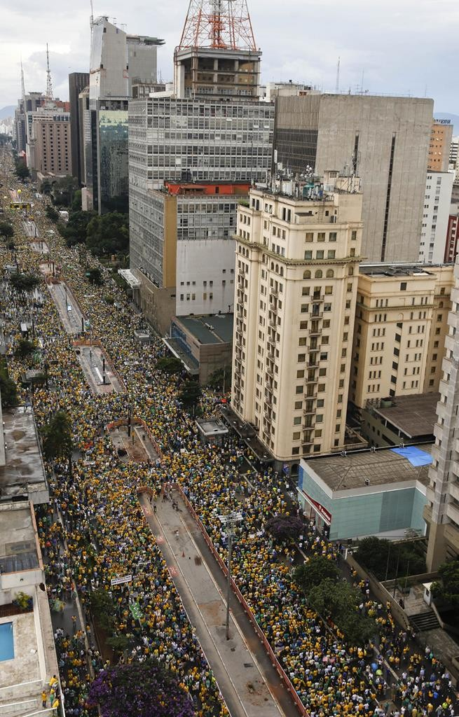 Demonstrators fill Paulista Avenue as they march to demand the impeachment of Brazil's President Dilma Rousseff in Sao Paulo, Brazil, on Sunday. (AP Photo/Andre Penner)