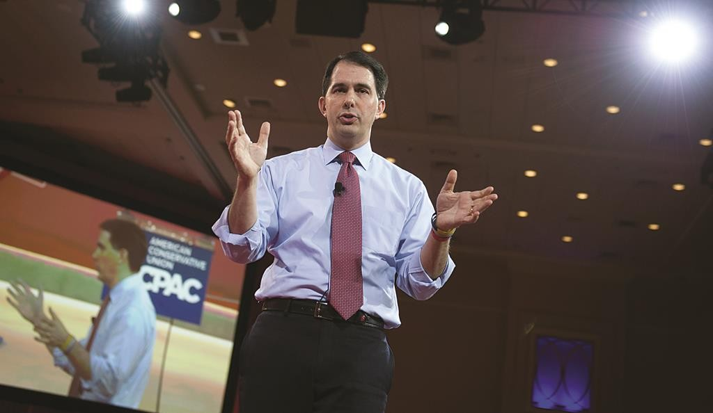 Wisconsin Gov. Scott Walker gestures while speaking during the Conservative Political Action Conference (CPAC) in National Harbor, Md. (AP Photo/Cliff Owen)