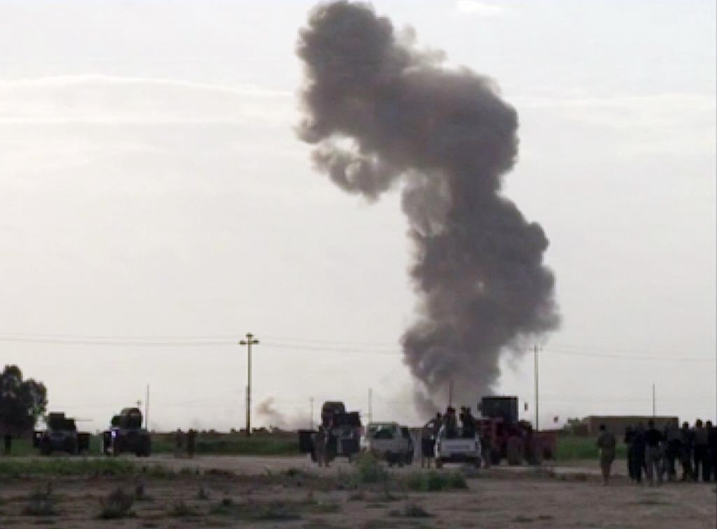 In this image captured from video footage, smoke rises from an explosion as Iraqi forces, Shiite militiamen and Sunni tribal fighters battle Islamic State terrorists for control of Tikrit, Iraq, Tuesday. (AP Photo via AP video)