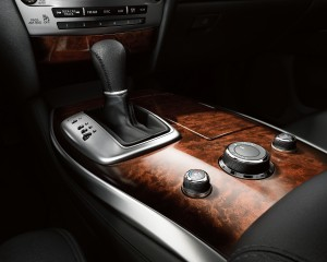 The 2015 Infiniti QX60 exudes luxury at every glance, with leather, wood and metal trim accents to class it up. (Infiniti/TNS)