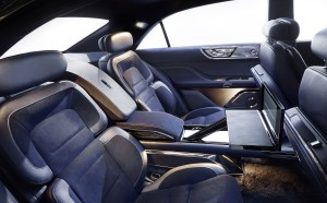 Rear-seat passengers enjoy the convenience of a tablet-supporting lap tray that deploys from the through-center console. It also features a champagne storage compartment. (Ford Motor Company)
