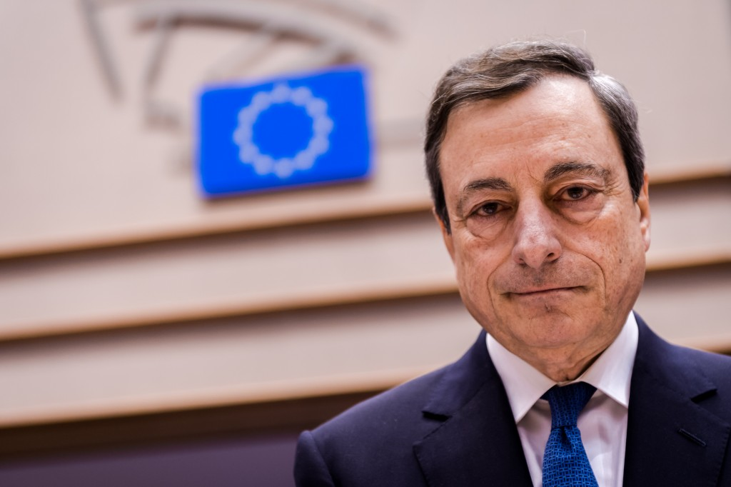 European Central Bank Governor Mario Draghi arrives for an Economic Affairs Committee meeting at the European Parliament in Brussels on Monday, March 23, 2015. Draghi presented the ECB's perspective on economic and monetary developments. (AP Photo/Geert Vanden Wijngaert)