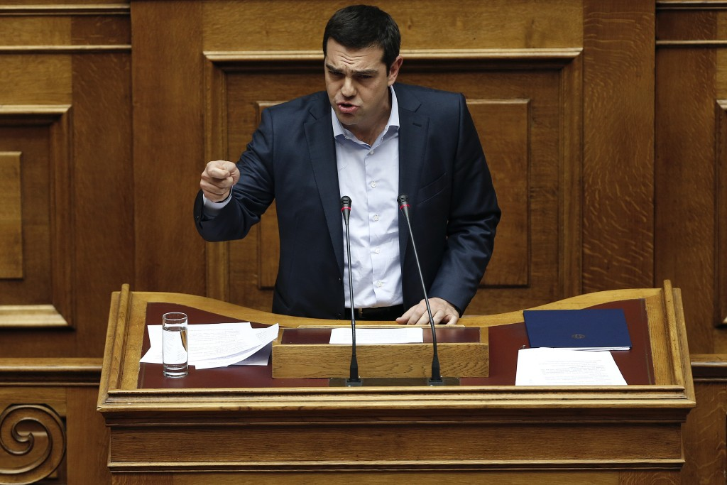 Greek Prime Minister Alexis Tsipras speaks during a parliamentary session in Athens on Monday, March 30, 2015. Tsipras called the special session of parliament to brief lawmakers on the course of recent troubled negotiations with bailout lenders to overhaul cost-cutting reforms. Greece is under pressure to convince creditors it has viable alternatives to the reforms, with government cash reserves running low. (AP Photo/Petros Giannakouris)
