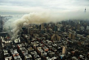 Smoke rises on Thursday from the scene of a large fire and a partial building collapse on St. Mark's Place and Second Avenue in New York City's East Village. (AP Photo/NYPD Special Ops)