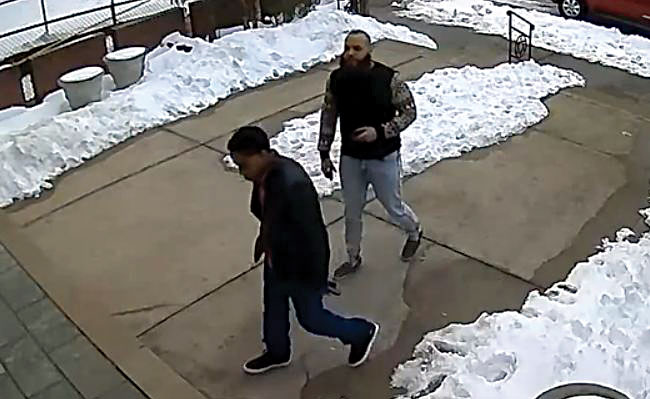 Two suspicious men are seen approaching the Edmund J. Safra Synagogue on Shabbos.