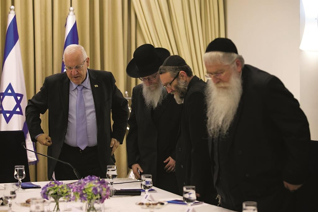 Members of the United Torah Judaism party sitting down with Israeli president Reuven Rivlin on Sunday. (Ohad Zwigenberg/POOL)