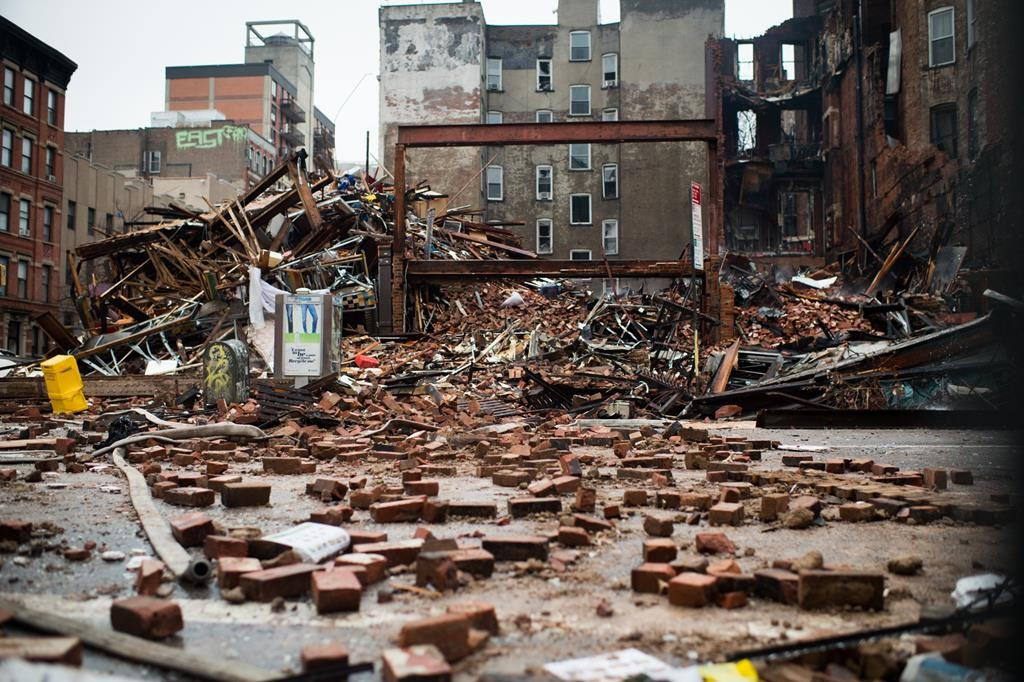 A pile of debris remains Friday at the site of a building explosion in the East Village. (AP Photo/New York Times, Nancy Borowick)