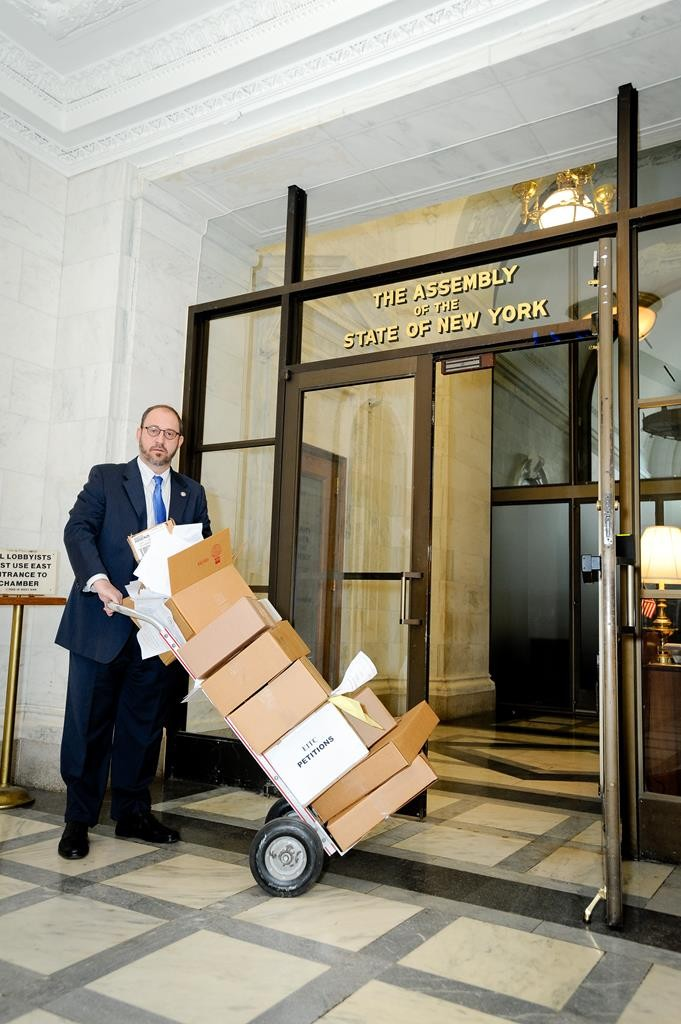 State Sen. Simcha Felder on Tuesday delivering to the Assembly Speaker's office tens of thousands of petitions from parents asking for tuition relief through a tax credit.