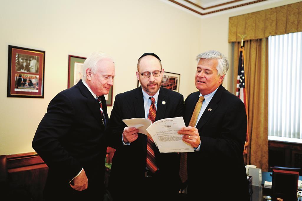 Sen. Simcha Felder (center) discusses the education tax credit bill with Senate Majority Leader Dean Skelos (R) and Sen. Marty Golden. (Office of Sen. Felder)
